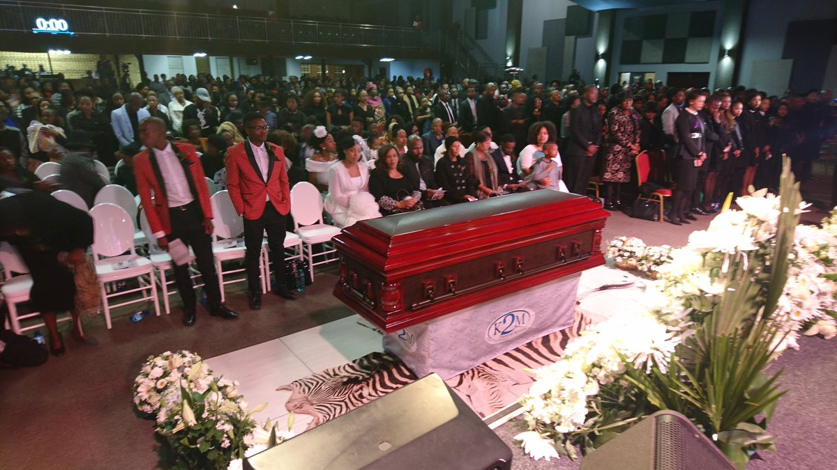 Dumi Masilela's family, wife and brothers seated in front ...